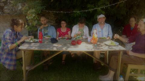 people eating together at a table